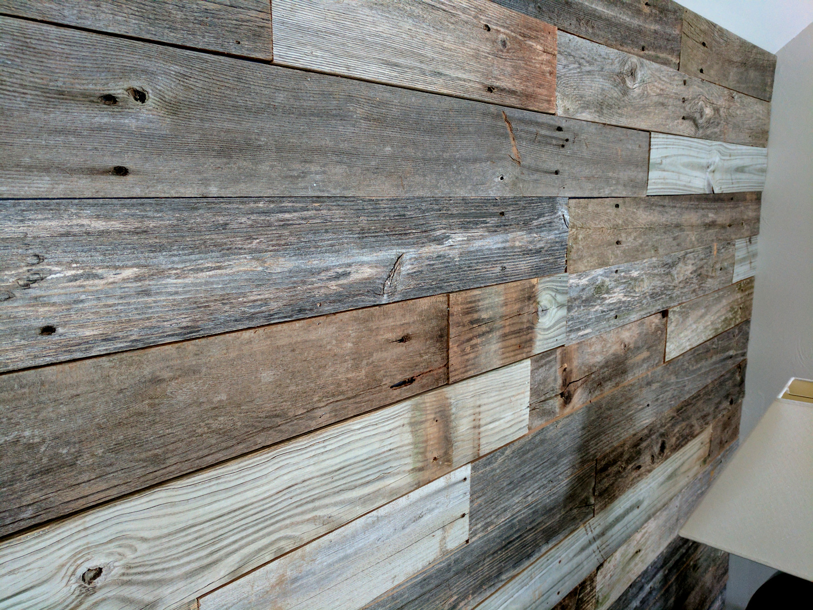 Reclaimed wind fence wall planks sustainable lumber company for Recycled hardwood