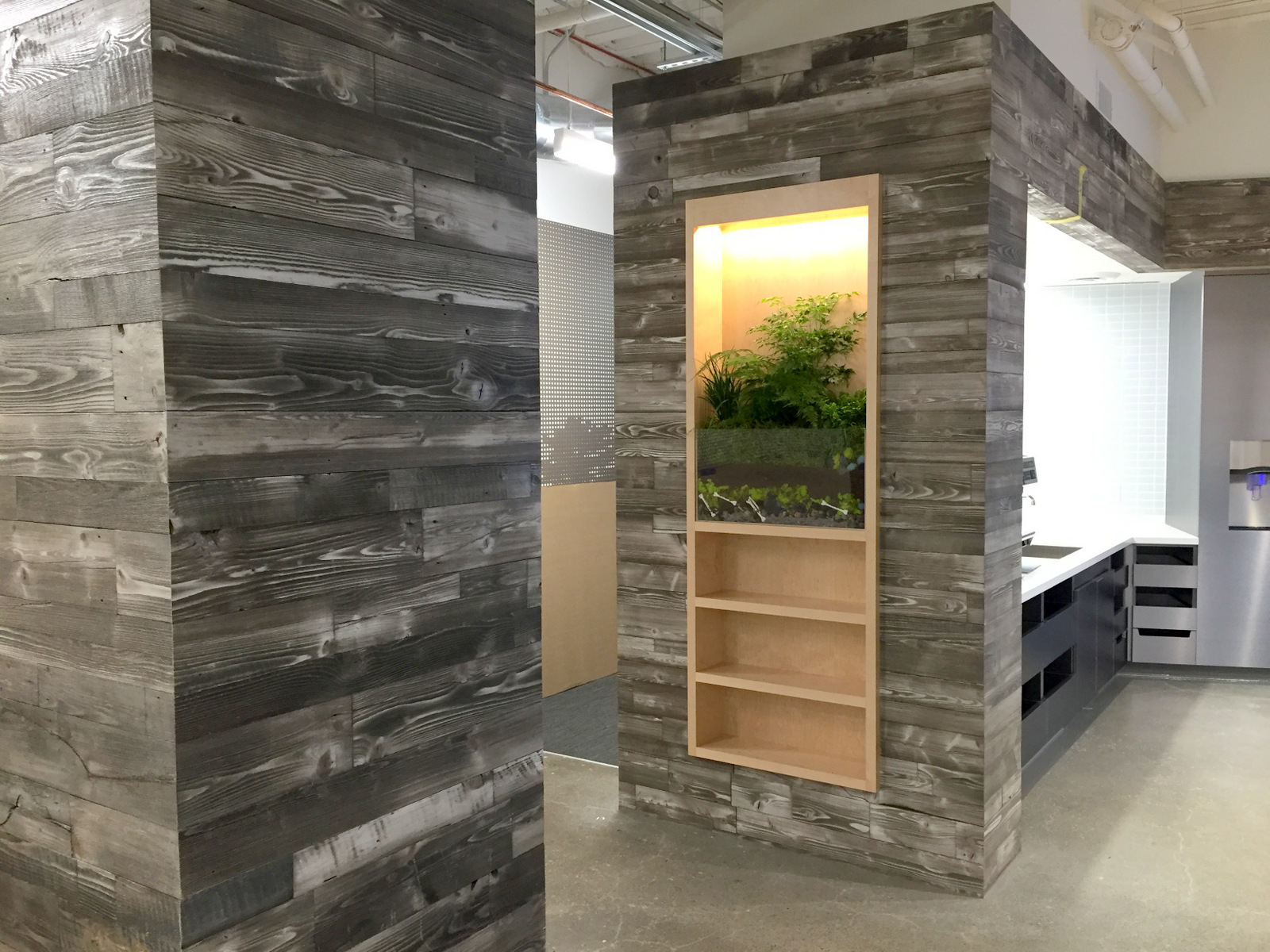 Adding a reclaimed wood wall sustainable lumber company for Reclaimed pallet wood wall