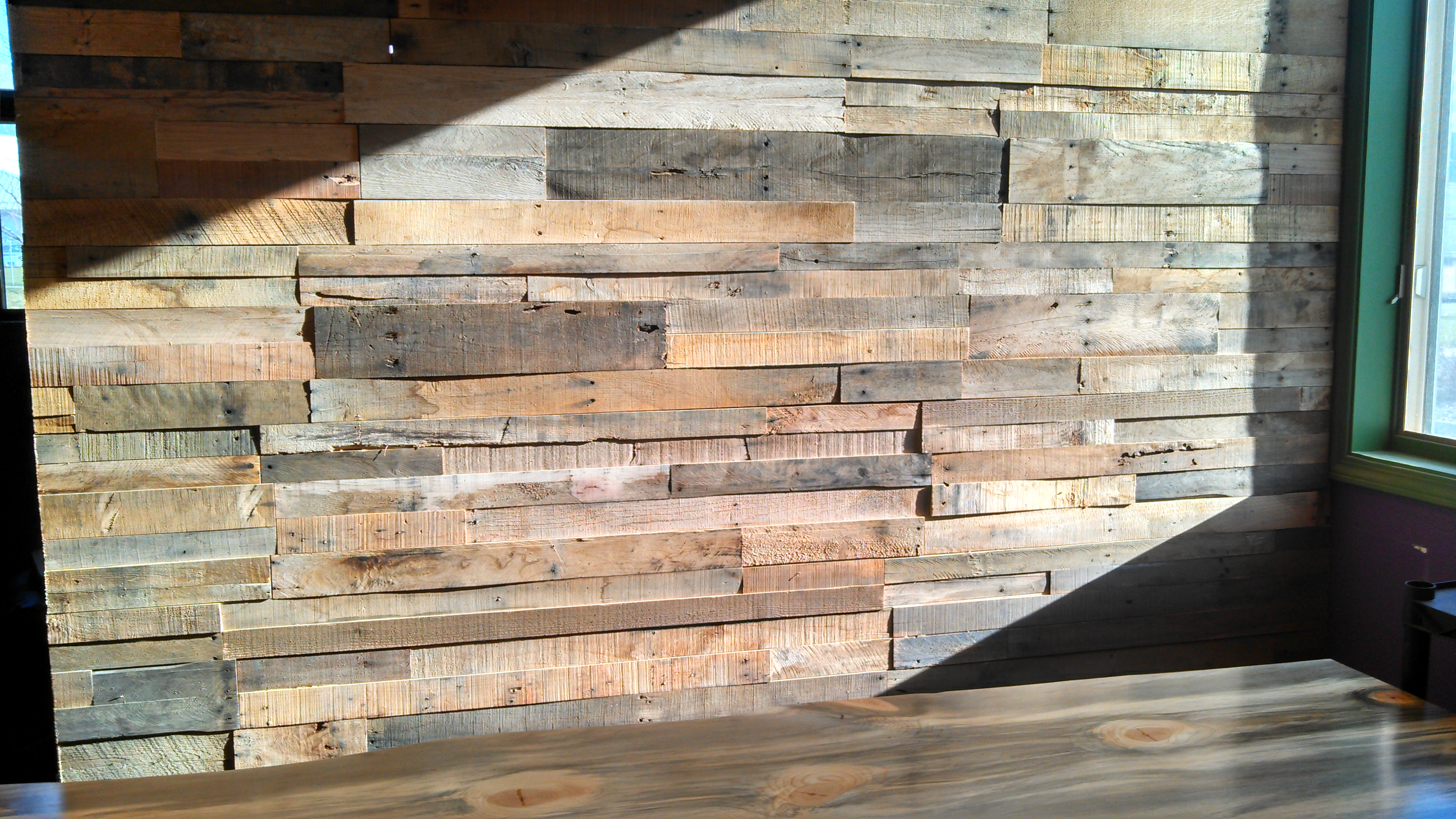 Pallet wood wall video sustainable lumber company - Wooden pallet accent wall ...