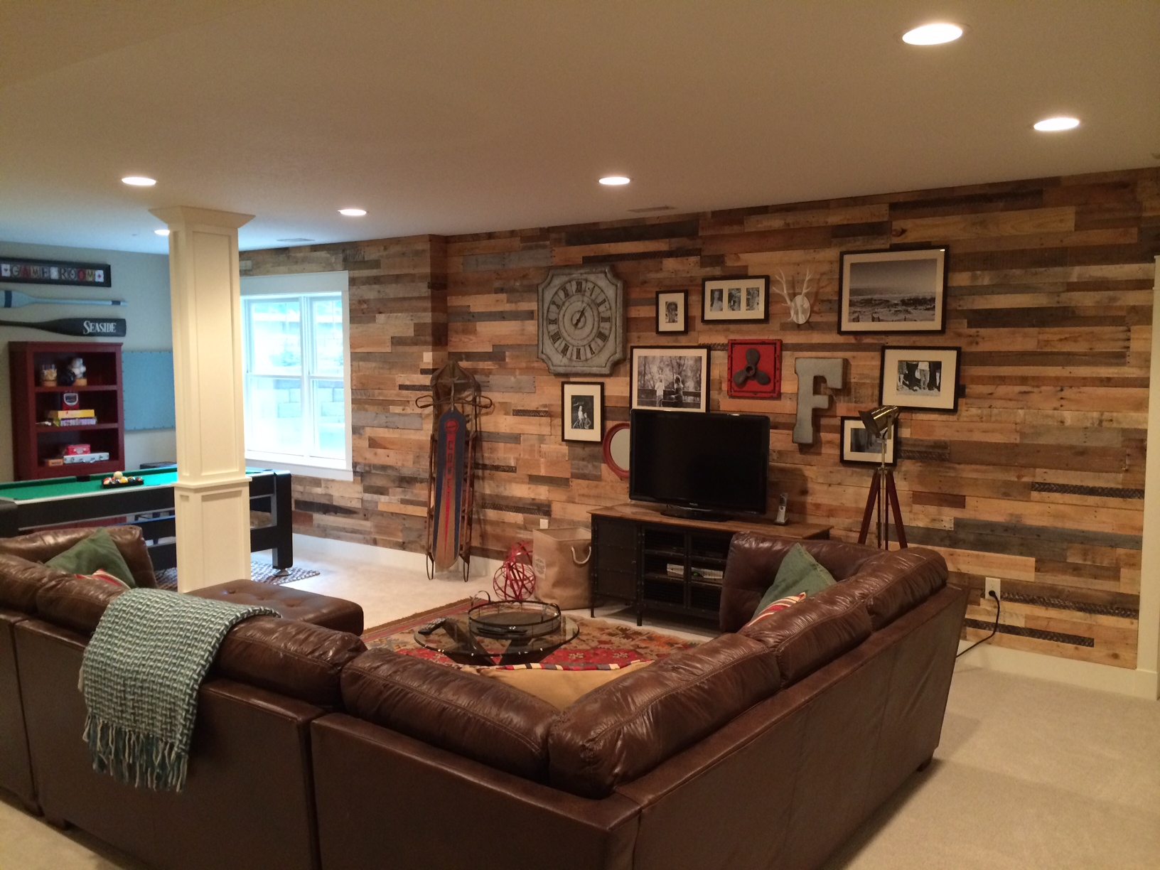 Recycled pallet wood accent wall sustainable lumber company - Wooden pallet accent wall ...